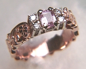 Bridged ring with sculpted ivy pattern and emerald cut pink sapphire
