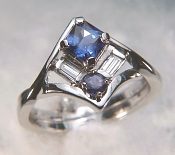 Custom platinum ring set with a square blue sapphire, diamond baguettes and a round purple sapphire
