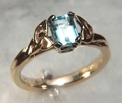 14KY Celtic Vanessa Ring with a 7x5mm emerald cut aquamarine
